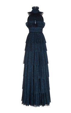 This sleeveless **Rasario** gown features a mock neck, a fitted bodice, and a tiered maxi skirt.