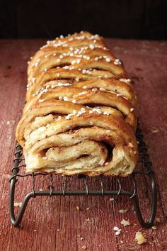 In the recipe for this sweet coffee-time snack, the yeasty cardamom-spiced dough is cut into a decorative pattern before baking.
