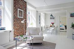 white interior with exposed brick Swedish Interior Design, Swedish Interiors, Apartment Interior Design, Interior Photo, Modern Interiors, White Brick Walls, Exposed Brick Walls, Brick Feature Wall, All White Room
