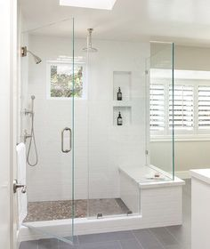 Modern+bathroom+features+a+walk-in+shower+clad+in+a+pebbled+floor+illuminated+by+a+skylight.
