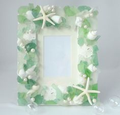Beach Decor Sea Glass & Seashell Frame - Nautical Shell Frame w Beach Glass, Starfish, Pearls, 5x7 Green. $79.00, via Etsy.