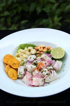 Peruvian fish cebiche recipe prepared with fresh fish, limes, onions, spicy peppers, and cilantro. Served with boiled corn, cancha, and sweet potato chips.