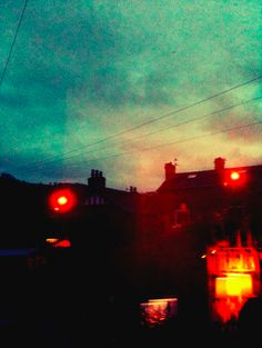 Loving the contrast...Black buildings with red lights then a blue/turquoise sky :)
