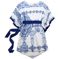 Blue and white baroque-printed dress made of polyester fabric. Cotton percale lining.