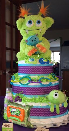 Diaper cake for monster theme baby shower by dianna Baby Shower Diapers, Baby Shower Fun, Baby Shower Cakes, Baby Shower Parties, Baby Shower Themes, Baby Shower Gifts, Shower Ideas, Baby Gifts, Monsters Inc Baby Shower