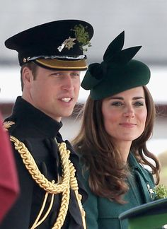 Catherine, Duchess of Cambridge and Prince William, Duke of Cambridge stand on the dias during the St Patrick's Day parade at Mons Barracks ...