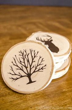 DIY Painted Wood Slice Coasters - cut a vinyl stencil or buy a pre-made one from the craft store for these easy and personal handmade gifts.  (They make great gifts for guys!)