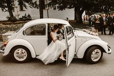 we adore this classic wedding getaway car captured by Kevin Klein
