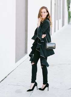 Sydne Style shows all black outfit ideas for holiday parties in exress black jeans on sale