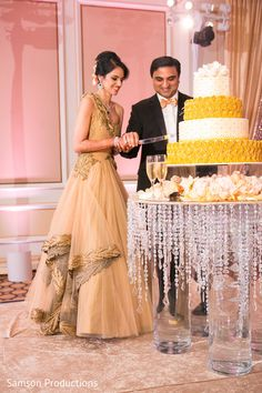 Indian couple cutting the wedding cake http://www.maharaniweddings.com/gallery/photo/91844