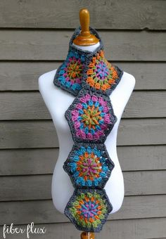 Hexagon scarf made with Lion's Pride Woolspun! Crochet the Strawflower Hexagon Scarf with 5 balls of Woolspun (in Pumpkin, Aquamarine, Avocado, Charcoal, and Orchid - or choose your own colors) and a size K mm) crochet hook. Crochet Scarves, Crochet Shawl, Free Crochet, Knit Crochet, Crochet Winter, Crochet Granny, Crochet Motif Patterns, Hexagon Pattern, Crochet Designs
