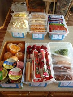Set up bins weekly, kids choose the number of items as posted and pack their own lunch - genius!