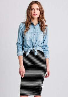 Designed with plenty of stretch, this versatile black and white striped skirt is crafted in an ultra-soft fabric and features a hidden elastic waist.