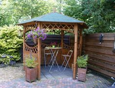 The alluring gazebo idea is making this small corner of the garden seems perfect for your great coffee and tea-time wisdom. The perfection is attractively provided by the green trees that surround the gazebo. Hot Tub Gazebo, Backyard Gazebo, Wooden Gazebo Kits, Modern Gazebo, Large Gazebo, Curved Pergola, Pergola Designs, Plein Air, Garden Furniture