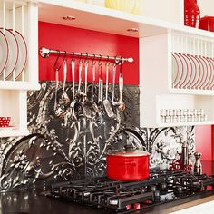 I love the red and white with the beautiful detail of the pressed metal as a practical backsplash.