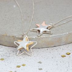 This gorgeous triple star necklace has a trio of three stars of  various sizes and finishes. You can chose to have the middle star in  rose gold or yellow gold vermeil.#jewellery #jewelry #star #necklace #silver #gold #wedding #boho #handmade #three #rosegold #pendant