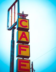 Cafe Sign. I love discovering old signs along the Texas highways. Photograph by Sonja Quintero.