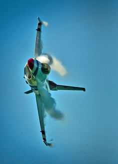 Pulling G's and clouds. Maj. Blaine Jones, Thunderbird 5 of the US Air Force Thunderbirds Demonstration Team, performs a Max Turn maneuver during a practice show at Daytona Beach, Florida. (U.S. Air...