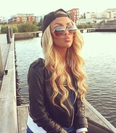 Like this look! Baseball cap and a leather jacket. Great idea for later in the fall months.