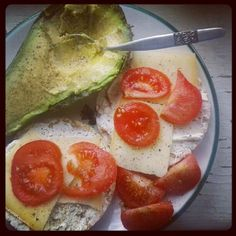 Breakfast!!!    #avocado #tomatoes #cheese #ricewafers