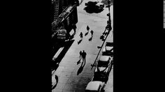 """People are seen from an elevated train platform in New York in 1950. Bigaignon met Feinstein a few years ago. When he started his own gallery, he worked with Feinstein's widow, Judith, to get an exhibition started. """"Every photograph I had in my hand was like a masterpiece to me,"""" he said."""