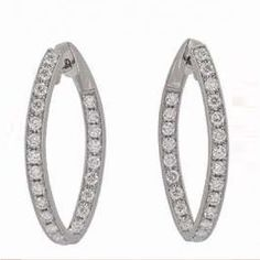 18 karat white gold diamond studs! They are the perfect gift that are wearable in any occasion!