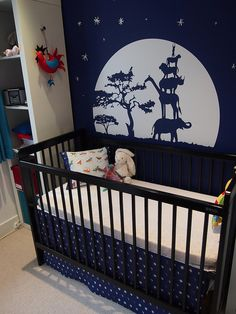 beautiful nursery in the artist's own Moonlit Moth Fandango fabric coordinates