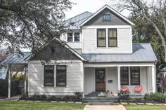 farmhouse exterior by Clayton&Little Architects White siding, metal roof and black/dark grey window trim with accent color on shingled area above windows. Design Exterior, Exterior Siding, Exterior Remodel, Exterior House Colors, Wood Siding, Exterior Windows, Exterior Houses, Black Exterior, Up House