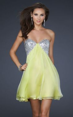Make a lasting impression at your prom, semi formal, or homecoming party in this short and sassy strapless dress by La Femme. Ideal for any special occasion this short dress in luxurious chiffon features a sequin sweetheart strapless bodice with a sexy open back design. A short formal dress in white, lavender purple, or light lime green with a sheer overlay on the short A-line skirt that will look amazing as you dance the night away.