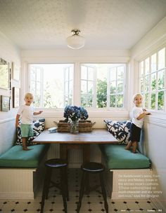 breakfast nook:  love the windows; cushions; table; stools; white walls; ceiling (tin?)