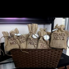 """Burlap favor bags for my sons train-themed birthday party. It's his 2nd birthday, but you could do """"train no. 3"""" for a 3rd birthday. Very easy and inexpensive."""
