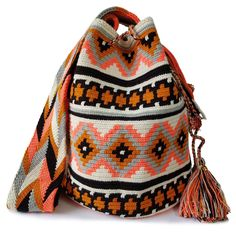 The stunning, one-of-a-kind, double thread Wayuu bag is 100% handmade and has been carefully crocheted by women from the Wayuu tribe in La Guajira, Colombia.This beautiful Wayuu bag that you are seeing was carefully crafted using a double thread technique.This versatile Wayuu bag is perfect for a night out, running errands, hiking, relax on the weekend, or to take to the gym.This piece represents approximately 10-15 days of work for a single artisan. Tapestry Bag, Tapestry Crochet, Knit Crochet, Crochet Bags, Knitted Bags, Fair Trade, Women Empowerment, Bucket Bag, Purses And Bags