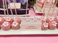 Pretty floral cake pops at a Christening Party #christening #cakepops