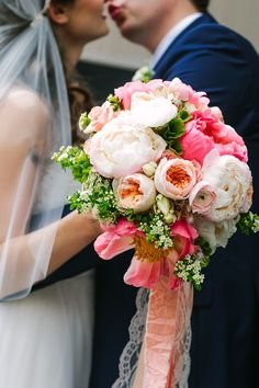 pink wedding bouquet - photo by A Brit and A Blonde http://ruffledblog.com/creative-toronto-wedding-with-stylish-backdrops