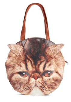 Feline Bold Bag. Youre in a feisty mood this morning, so you sling the handles of this cat bag over your shoulder! #brown #modcloth