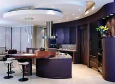 Kitchen: Beautiful Kitchen Design With Purple Curved Kitchen Cabinets Sets And Granite Countertops Kitchen Island Under Extractor Hood Plus Bar Stool And Sofa Beside: Ideas of Beautiful and Luxury Design of Modern Kitchen