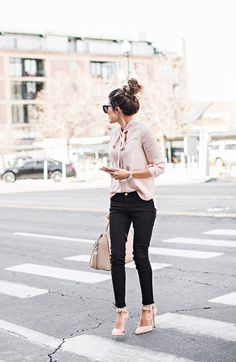 Freshen up your winter wardrobe with an injection of blush pink like Christine Andrew', who wears the trend in a gorgeous silky blouse and matching heels and bag. Top: Shopbop, Jeans: Nordstrom, Heels: Aminah Abdul Jillil.