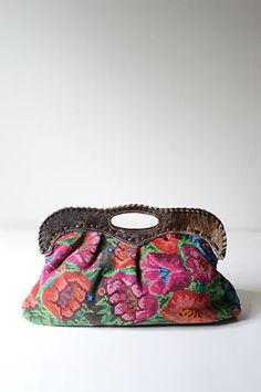 Handbag from Guatemala, featuring textiles handcrafted by the Mayan Huipil people and hide detailing.