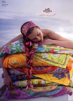 To have stacks of different, brightly patterned Hermes towels ready for the pool or beach...