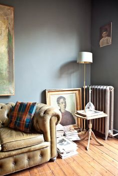 greyish blue feature wall with cream/caramel colour on other walls
