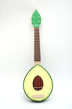 Avocado ukulele Avolele by Paul Celentano (celentanowoodworks), plywood. $450.00 Etsy: https://www.etsy.com/listing/110327425/new-plywood-avocado-ukulele-avolele  http://www.brookstropicals.com/blog/avolele-the-avocado-ukulele-2/