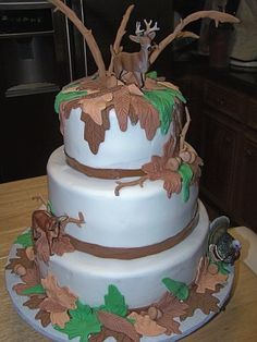 Hunting theme grooms cake. Buttercream with fondant accents. Plastic animals