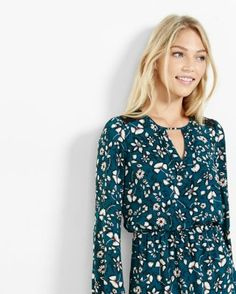 This pretty dress silhouette comes with some short skirt heat. The elastic waist puts you in control of the length while blousy sleeves, lace shoulders, and a delightful floral print keep things sweet.