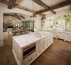 Gorgeous Kitchen Island, Flooring and Wooden Ceiling Beams