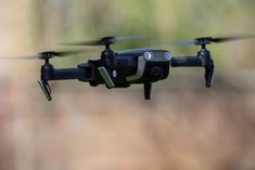 Eachine Foldable Drone: DJI Mavic Air on a Budget Ram Module, Foldable Drone, Docs Templates, Learn Programming, Model Train Layouts, Mavic, Security Camera, Model Trains, Recipes