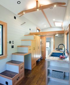 The Kestrel has a large set of storage stairs that leads up to the bedroom loft, which has a venting skylight.
