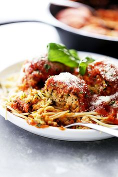 Ricotta Zucchini 'Meatballs' - Delicious, melt-in-your-mouth-amazing zucchini meatballs with ricotta and parmesan cheese, topped with a warm and bubbly tomato sauce!