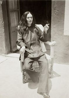 """""""I was born a bitch. I was born a painter."""" Photo: Frida, 1932, by her nephew, Guillermo Kahlo, framed in the show as an image in """"Frida at four stages of her life."""" This photo was taken seven years after the devastating crash that would partly define her life. On the back it is written: """"Frida right after surgery in 1946 - Coyoacan - she is now worse than ever, the pain is unimaginably intense."""""""