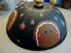 idea: use the black plastic bowl/with lid, use an old knob, paint the desired picture, use the bowl's lid for the cookie/sweets plate or a smaller place and just use this idea for a table cover over it to keep the sweets hidden until time to eat them!!!