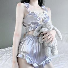 This luxurious silky satinlace-up lingeriesleep set has gorgeous hand-details including ruffled trim, a silky bows,...